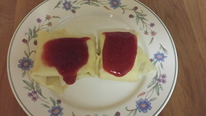 Cheese-Filled Crepes with Raspberry Sauce
